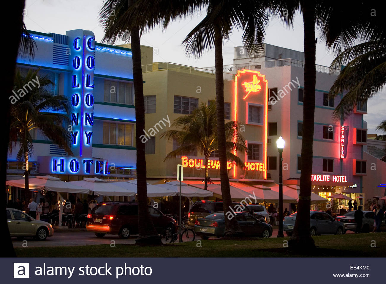 Neon signs adorning businesses and restaurants along Ocean Drive in the historic art deco South Beach. - Stock Image