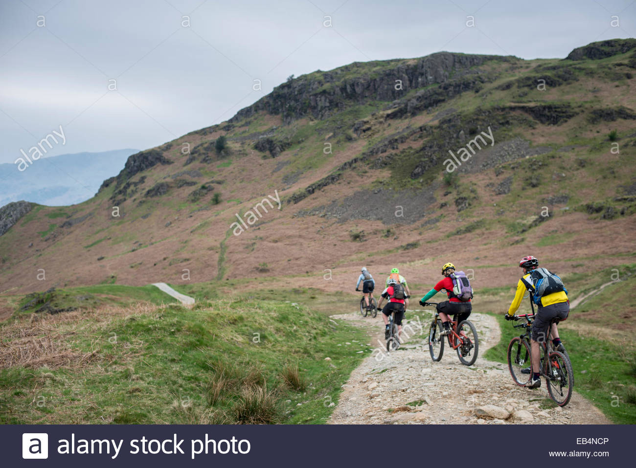 Mountain bikers near Loughrigg fell in the Lake District - Stock Image