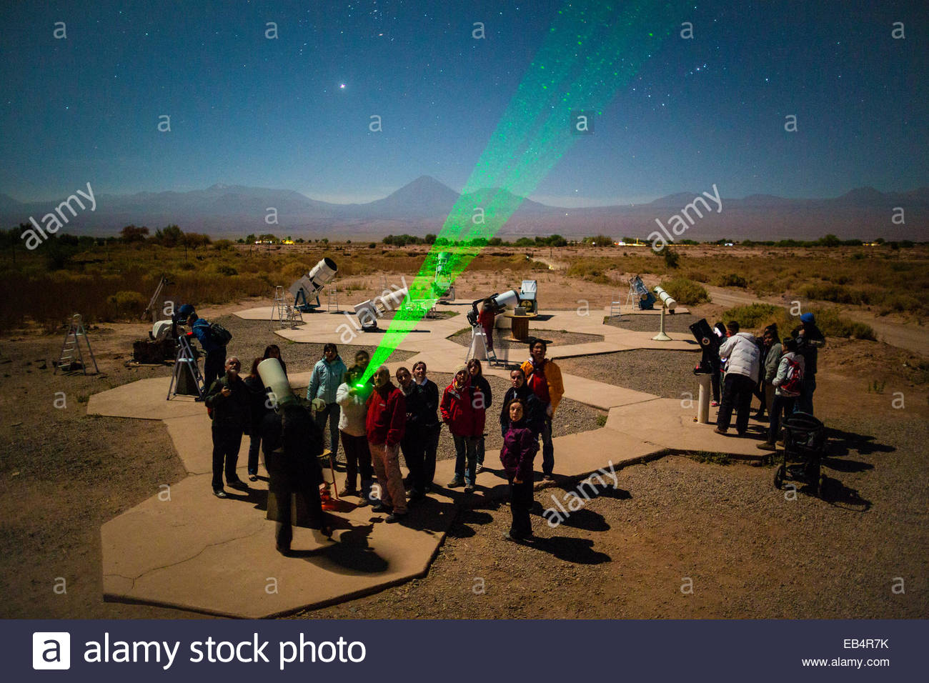 Tourists attend an astronomy lecture and observation outside San Pedro de Atacama, Chile. - Stock Image