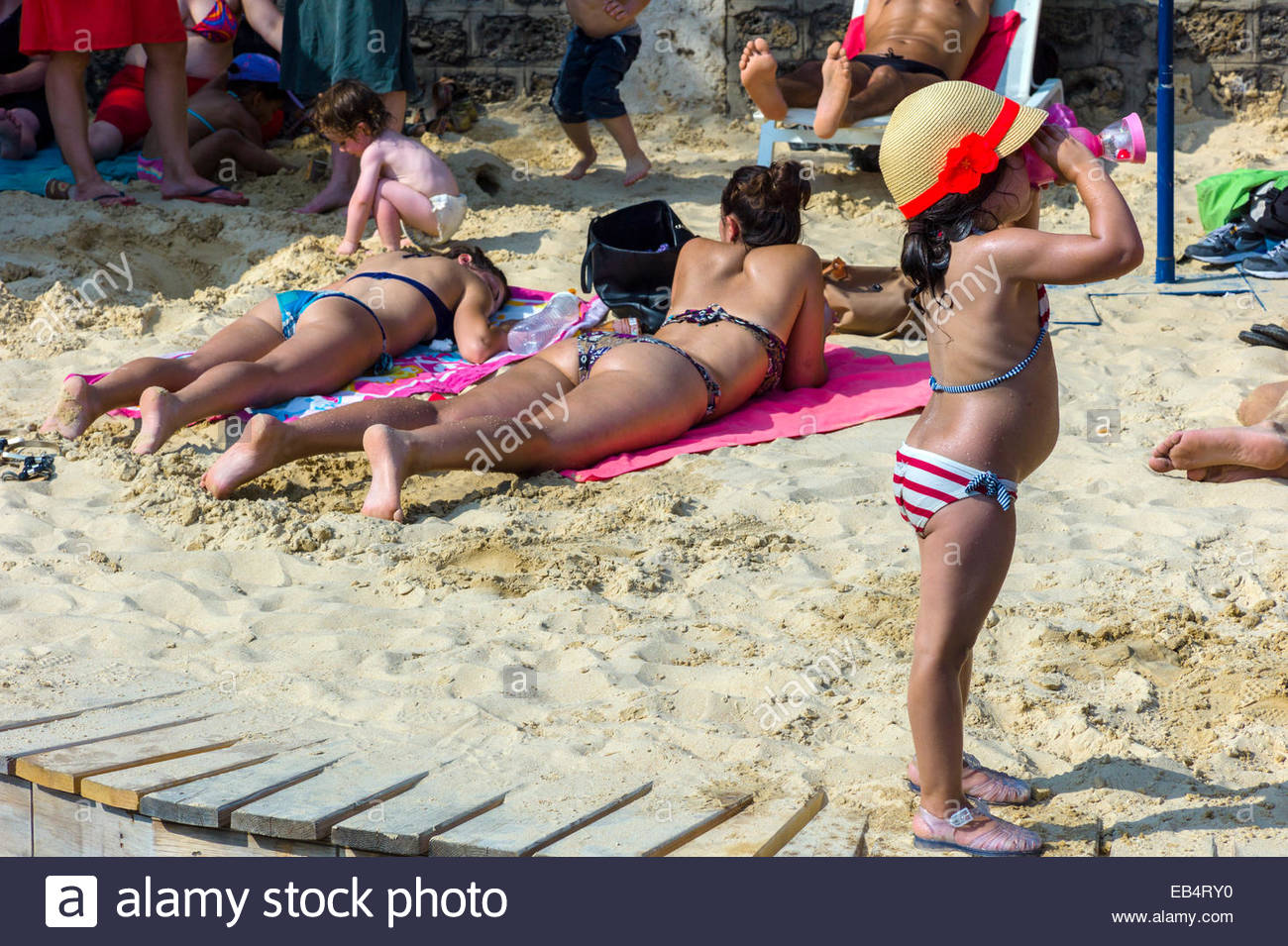 A girl plays at Paris Plage, an artificial, temporary beach on the bank of the Seine River. Stock Photo
