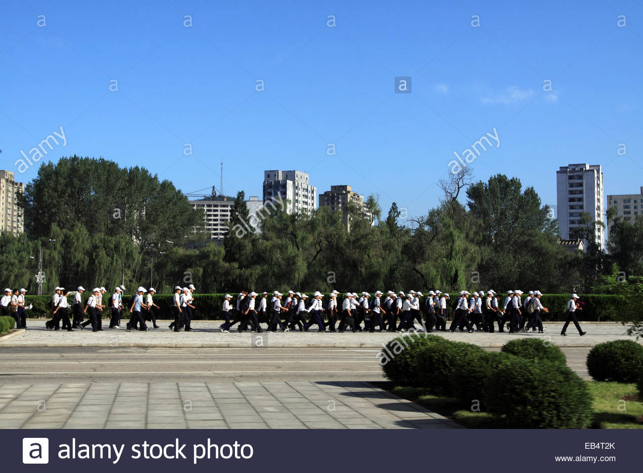 North Korean school children visit the Kumsusan Palace of the Sun, a mausoleum where the embalmed remains of former - Stock Image
