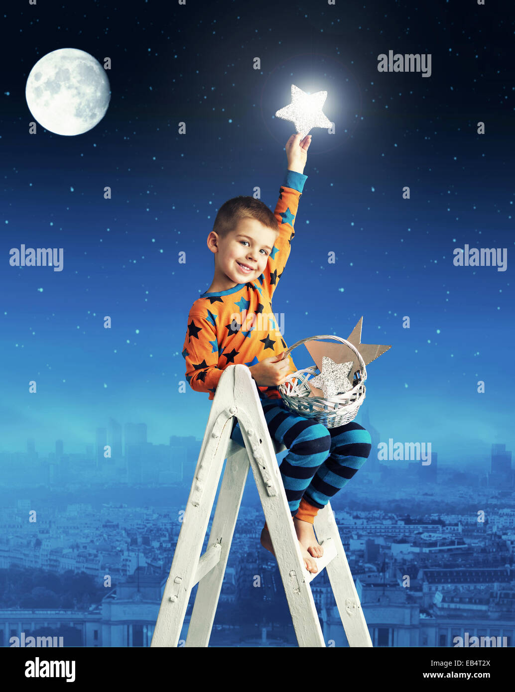 Little man collecting shining stars - Stock Image