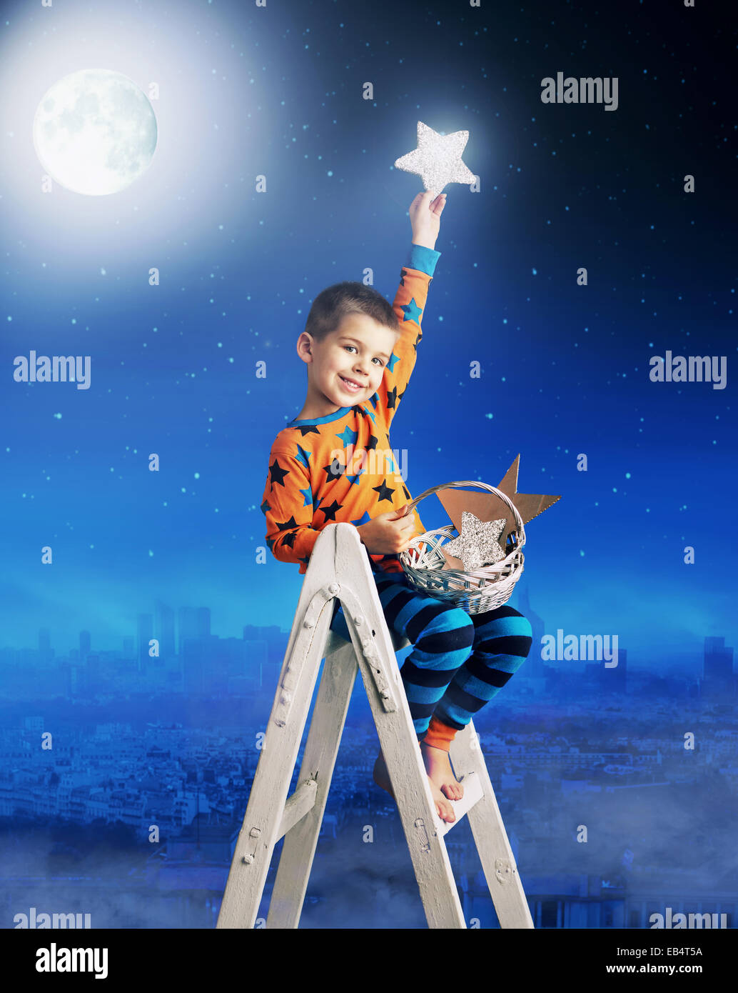 Cute boy in his own beautiful dream - Stock Image