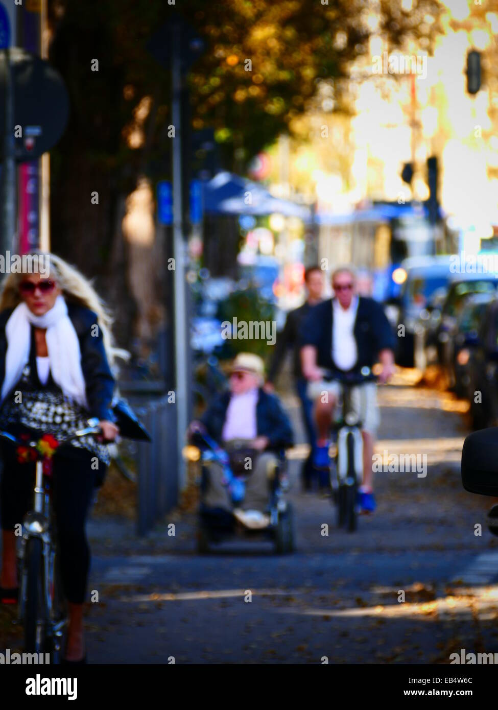 Anonymous out-focus Biker Bicycle on Bike Lane - Stock Image