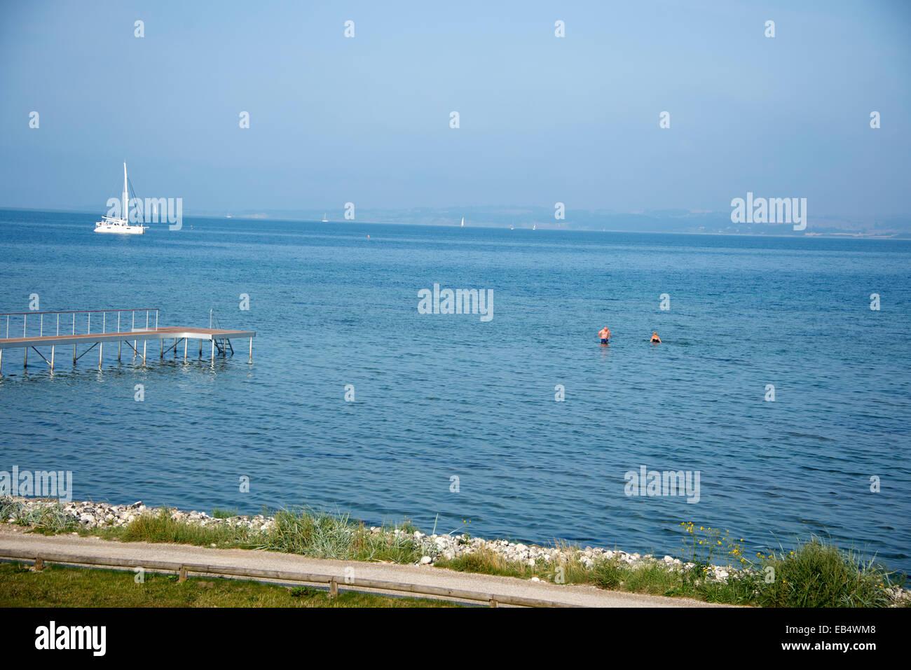 Two swimmers in the Kattegat Sea at Ebeltoft in East Jutland,Denmark - Stock Image