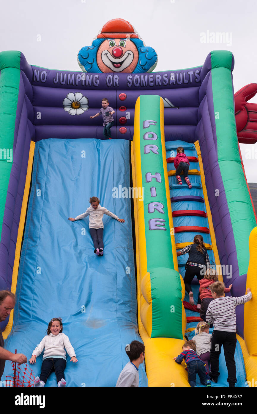 An inflateable slide at Reeth show , Swaledale in the Yorkshire Dales in Yorkshire , England , Britain , Uk - Stock Image
