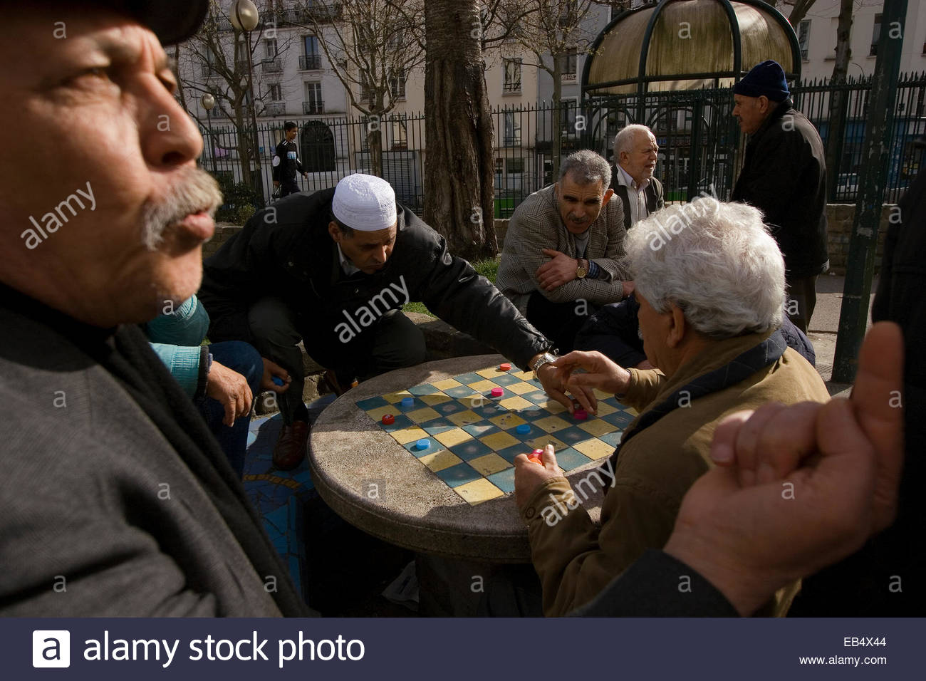 A group of men meet every afternoon to play checkers in the Square Leon Serpollet. - Stock Image