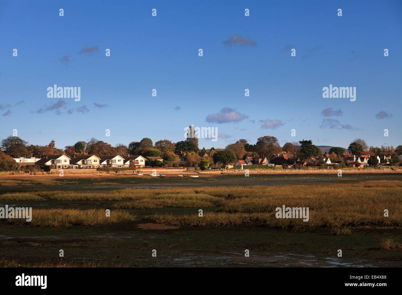 Panorama of houses at edge of sea at low tide Stock Photo