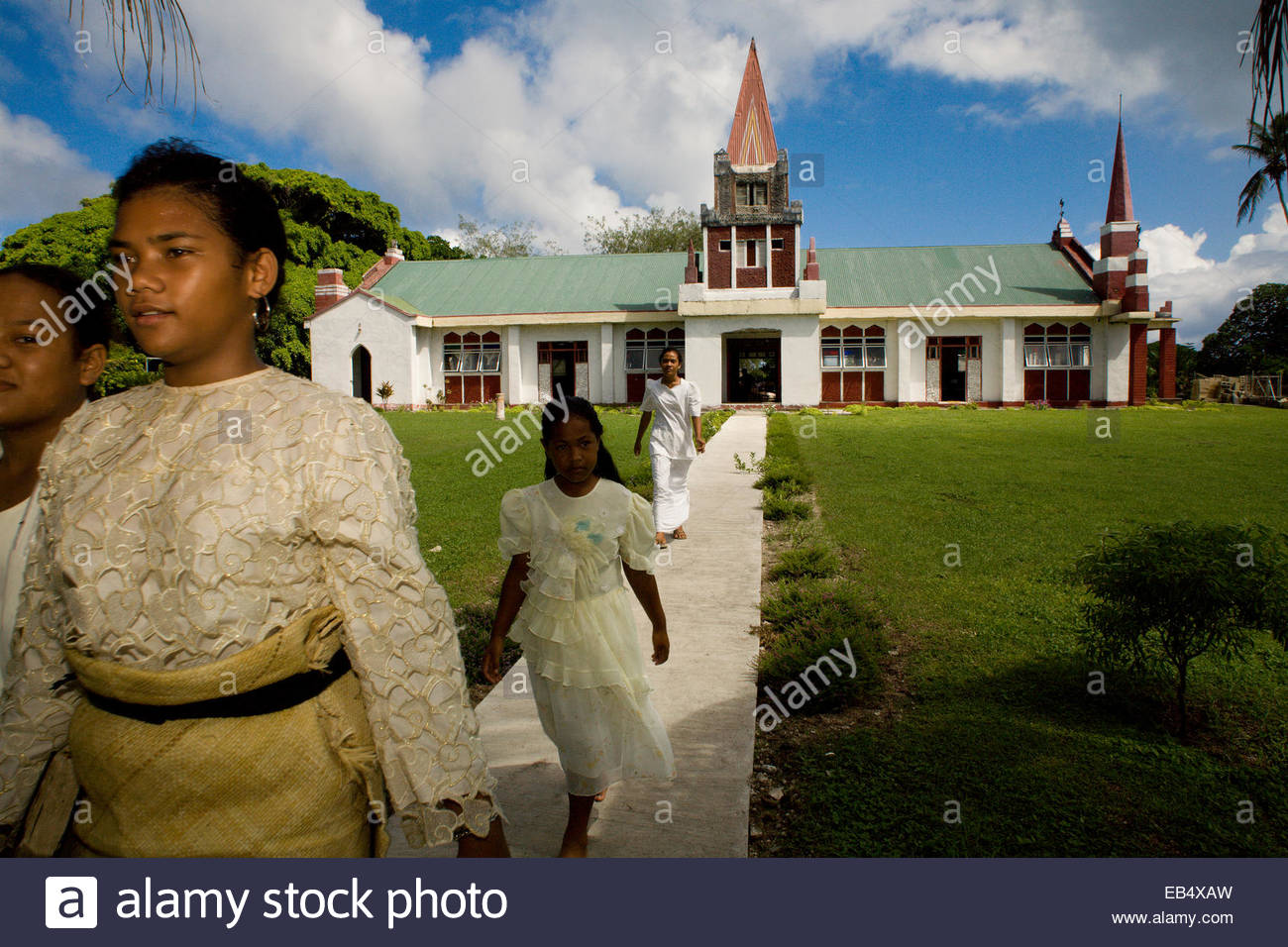 A family departs church on Easter morning. - Stock Image
