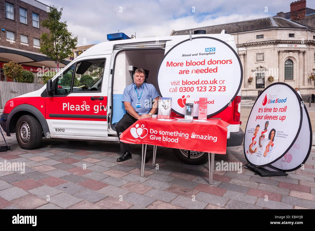 A man in van from NHS Blood donors trying to get more donors in Darlington , County Durham , England , Britain , - Stock Image