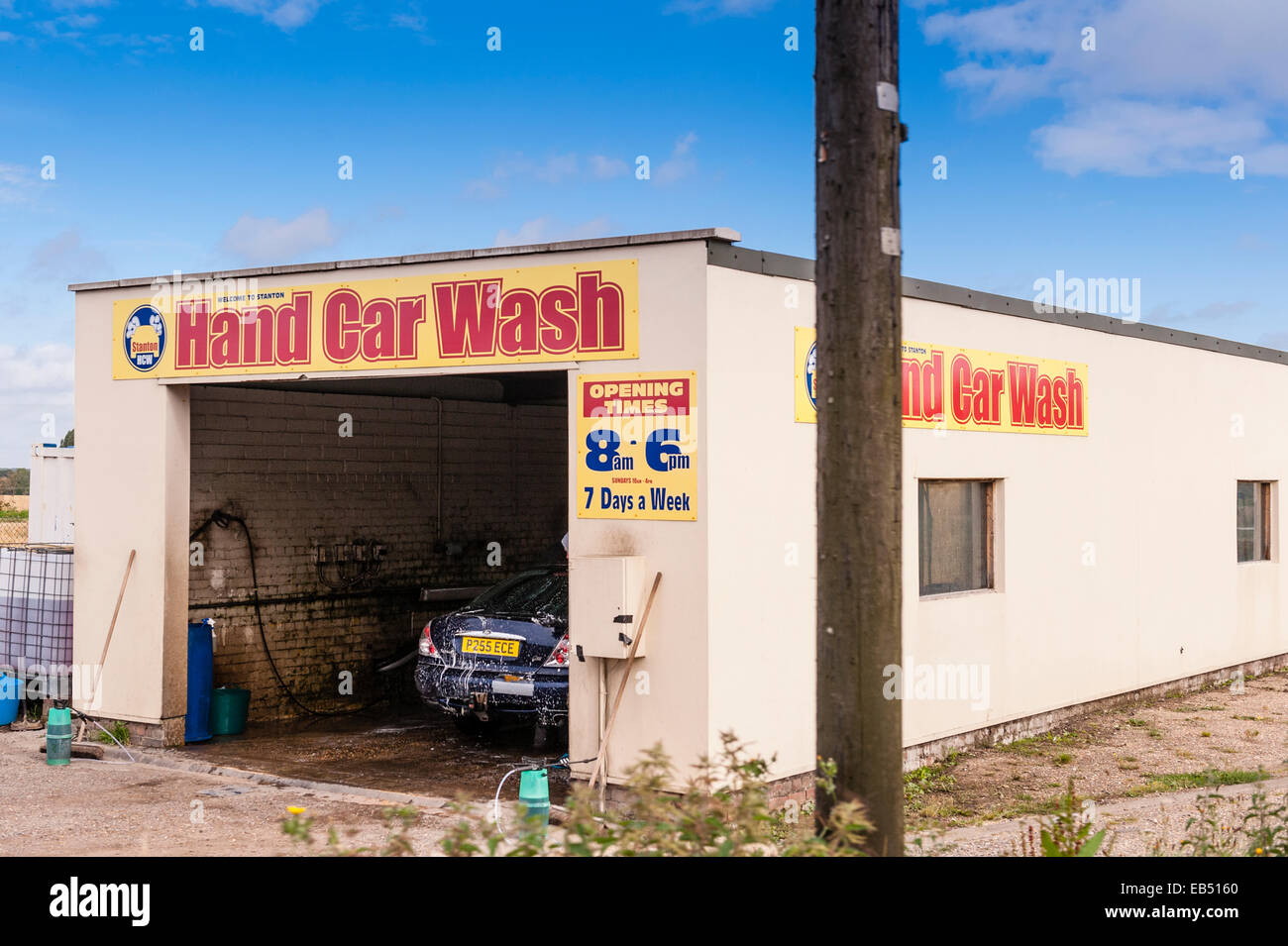 A hand car wash at the side of the road in the Uk - Stock Image