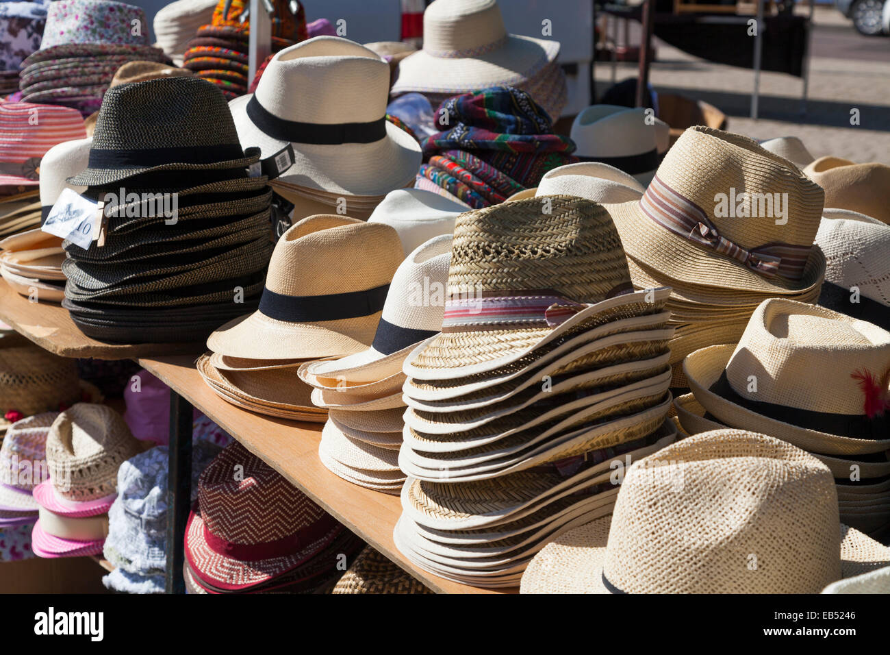 1bd6ab06626aba Stacks of mens summer hats for sale on market stall Stock Photo ...