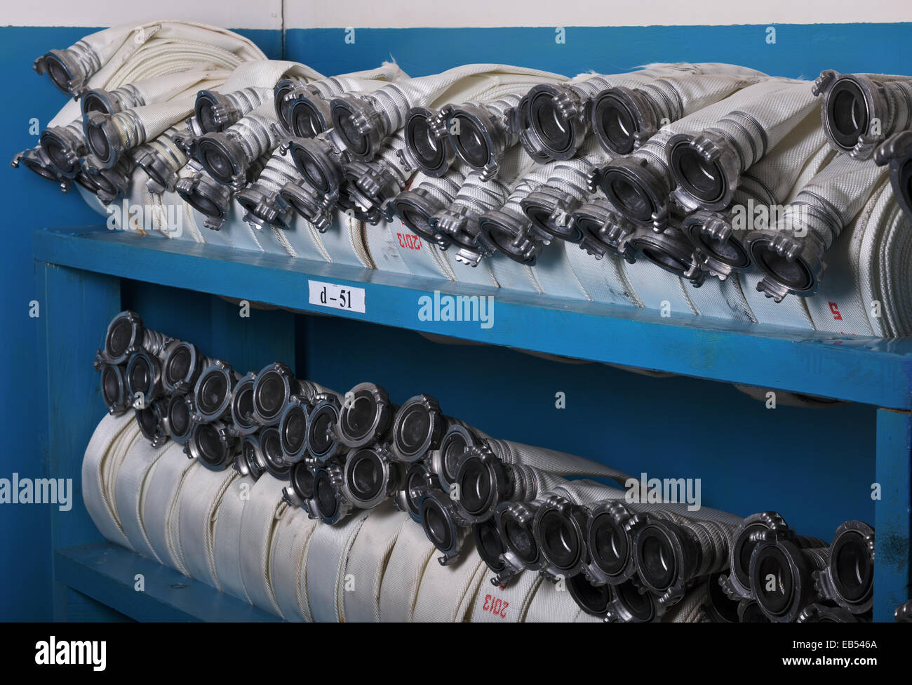 Storage of fire hoses to fire department - Stock Image