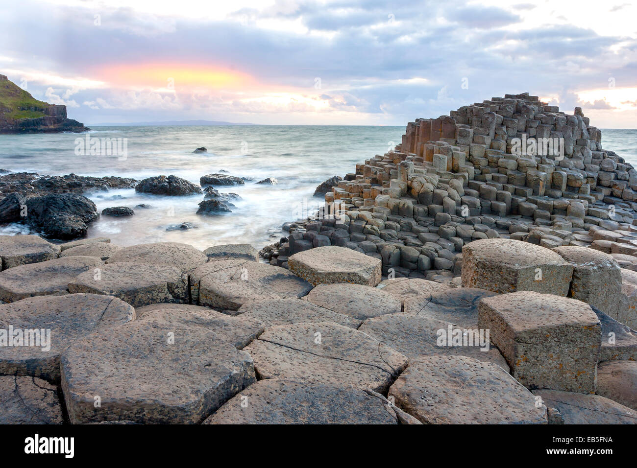 Sunset at Giant s Causeway in North Antrim, Northern Ireland - Stock Image