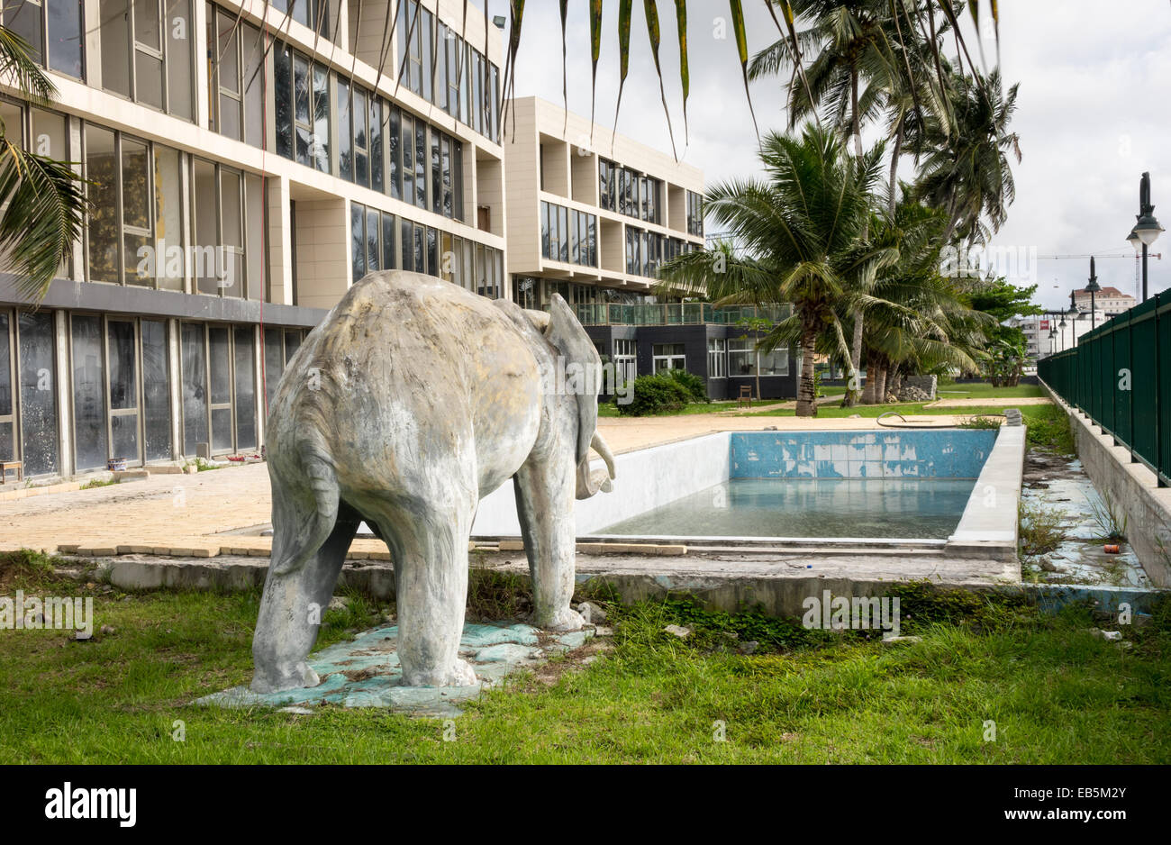 Elephant Statue And Unfinished Swimming Pool In Garden Of Apartment  Building In Bata, Equatorial Guinea