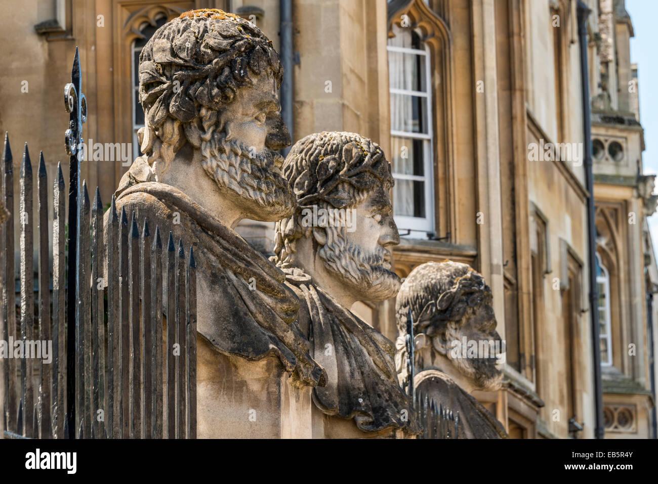 Grotesque decorative stone figure heads outside the Sheldonian Theatre, Oxford University Stock Photo