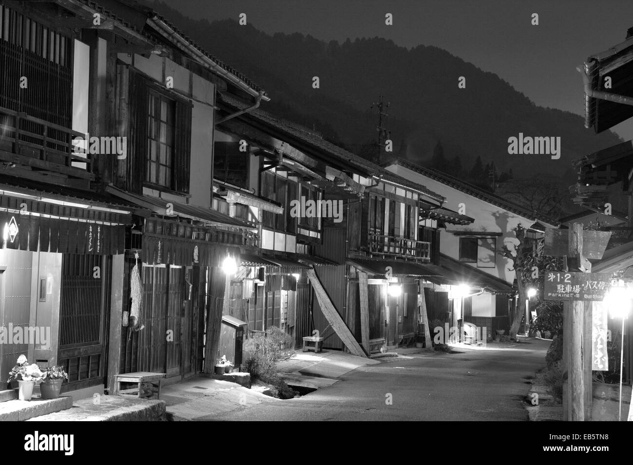 Tsumago, Japan. Nakasendo Highway, Street of Terashita, night-time, houses, inns and shops, shuttered and closed - Stock Image