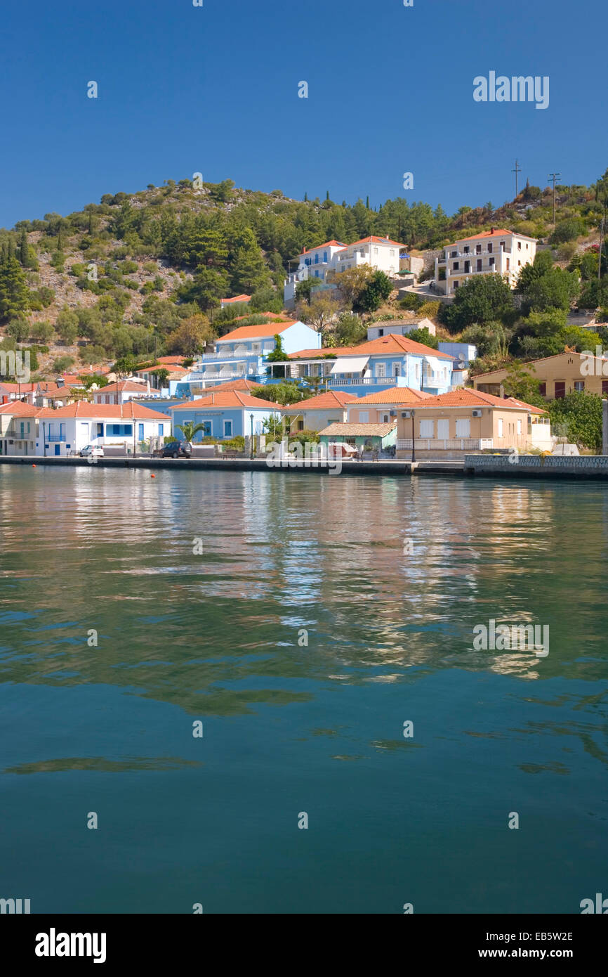 Vathy, Ithaca, Ionian Islands, Greece. Colourful modern houses overlooking the sheltered harbour. - Stock Image