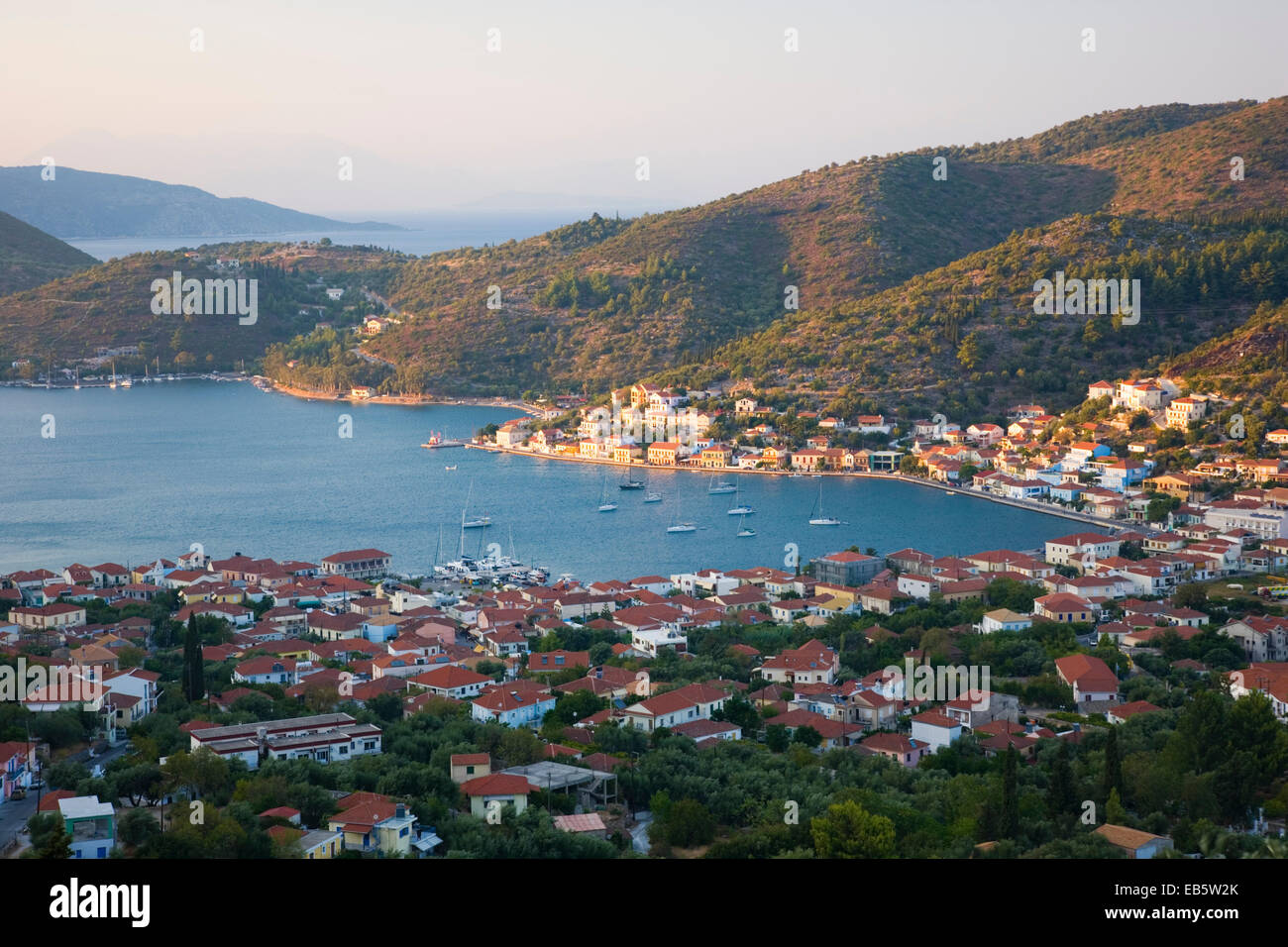 Vathy, Ithaca, Ionian Islands, Greece. View from hillside over the picturesque town and harbour, sunset. - Stock Image