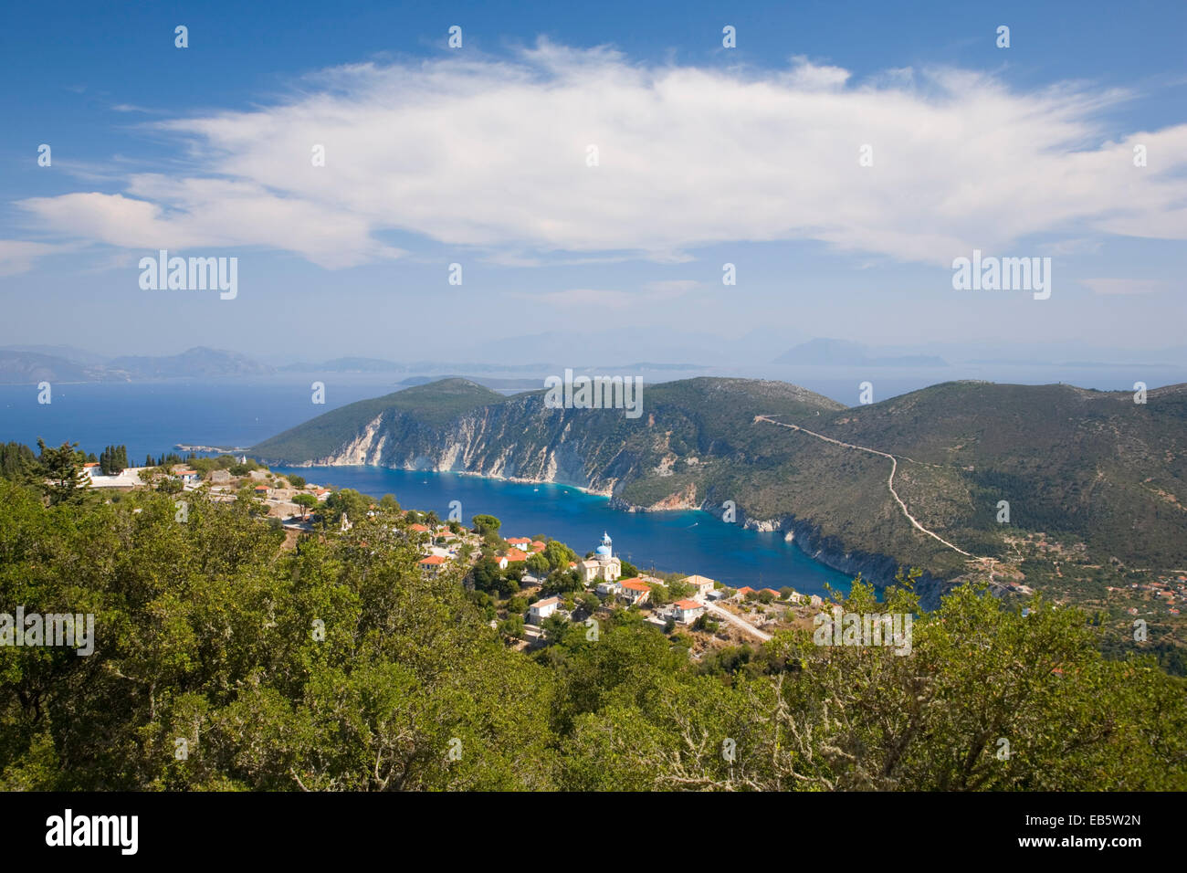 Exogi, Ithaca, Ionian Islands, Greece. View from wooded hillside above the village to Afales Bay and the distant - Stock Image