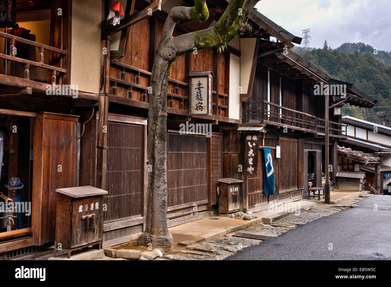 Tsumago, Japan. Street of Terashita, on Nakasendo Highway, ryokan, inns, minshuku and traditional shops in row along - Stock Image