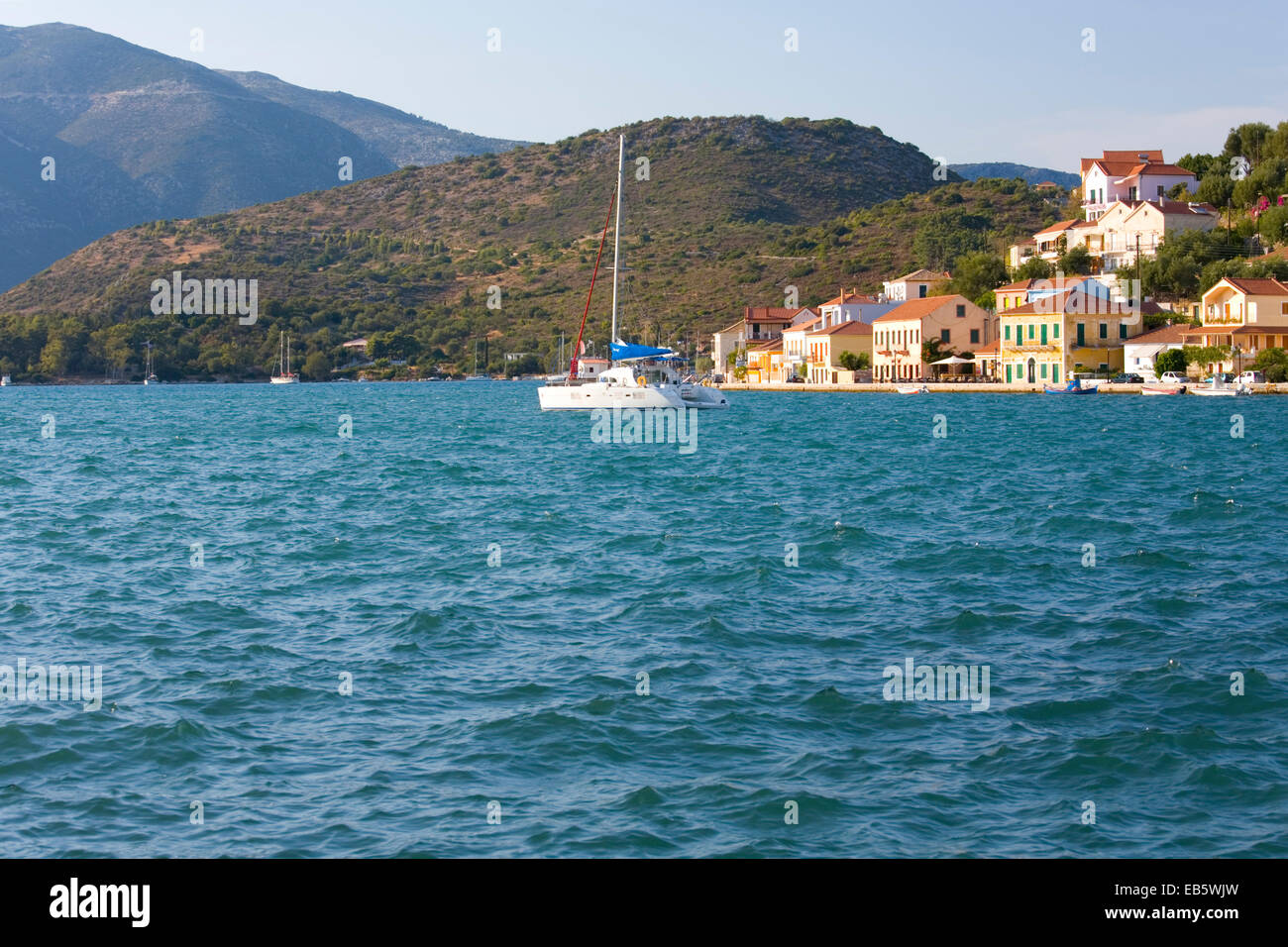 Vathy, Ithaca, Ionian Islands, Greece. View across the choppy waters of the harbour. - Stock Image