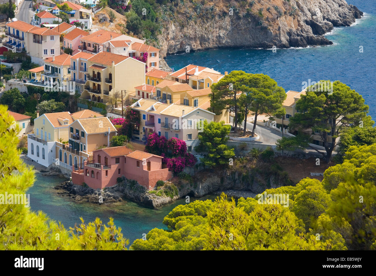 Asos, Kefalonia, Ionian Islands, Greece. View from hillside to pastel-coloured houses on isthmus above the harbour. - Stock Image