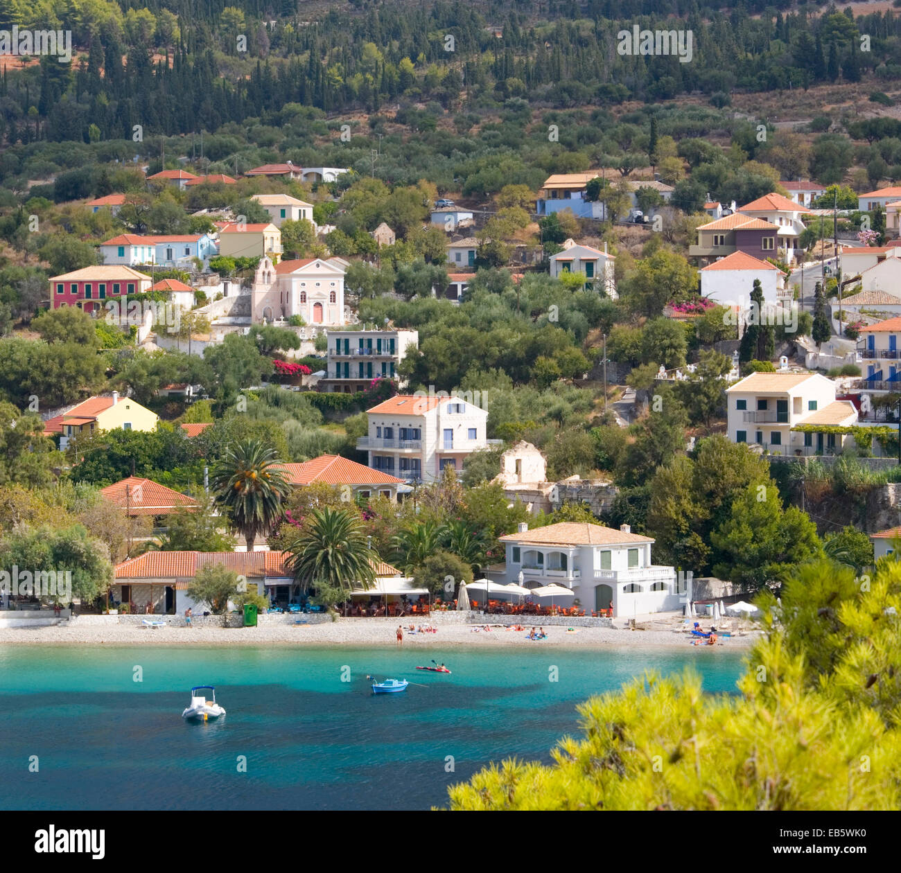 Asos, Kefalonia, Ionian Islands, Greece. View across picturesque harbour to the village and beach. - Stock Image