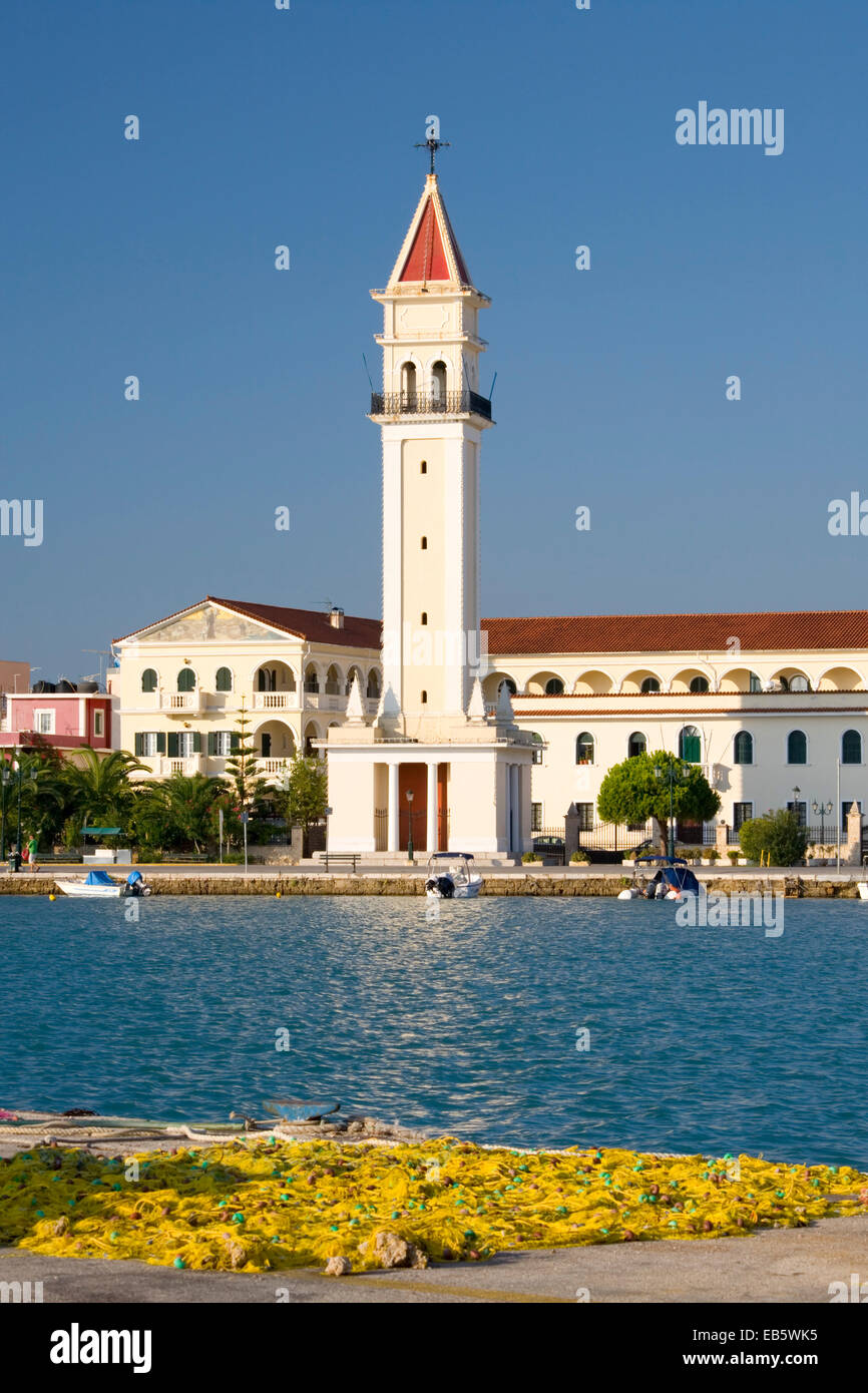 Zakynthos Town, Zakynthos, Ionian Islands, Greece. View across harbour to bell-tower of the Cathedral of Agios Dionysios. Stock Photo