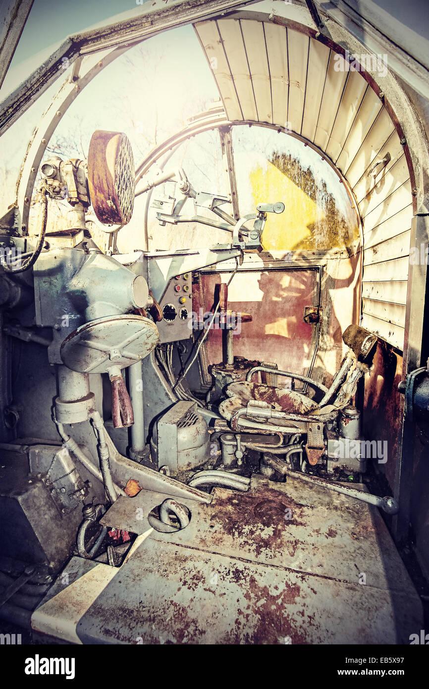 Retro filtered picture of machine gun cockpit. - Stock Image