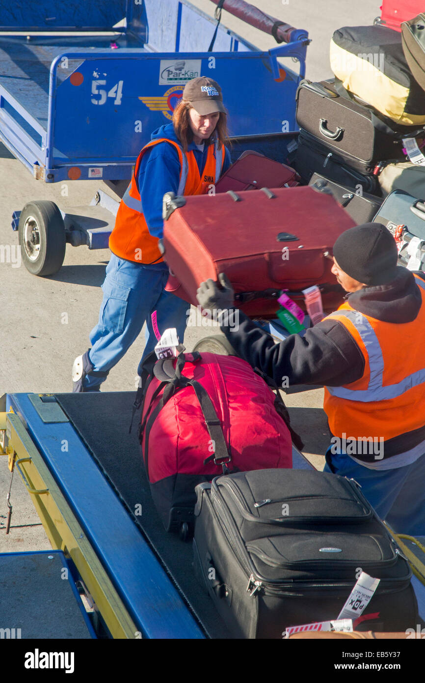 Detroit, Michigan - Baggage handlers load luggage onto a Southwest Airlines plane at Detroit Metro Airport. - Stock Image