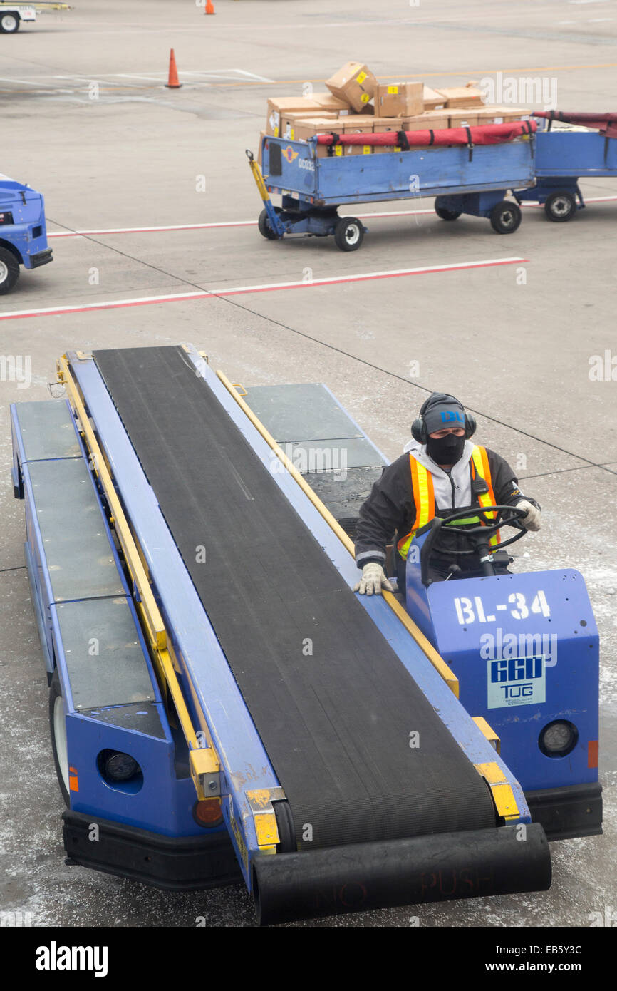 Denver, Colorado - A baggage handler prepares to unload luggage from a Southwest Airlines plane at Denver International - Stock Image