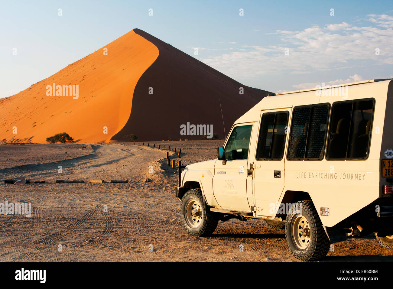 Safari Vehicle and Sand Dune in Sossusvlei National Park - Namib-Naukluft National Park, Namibia, Africa - Stock Image