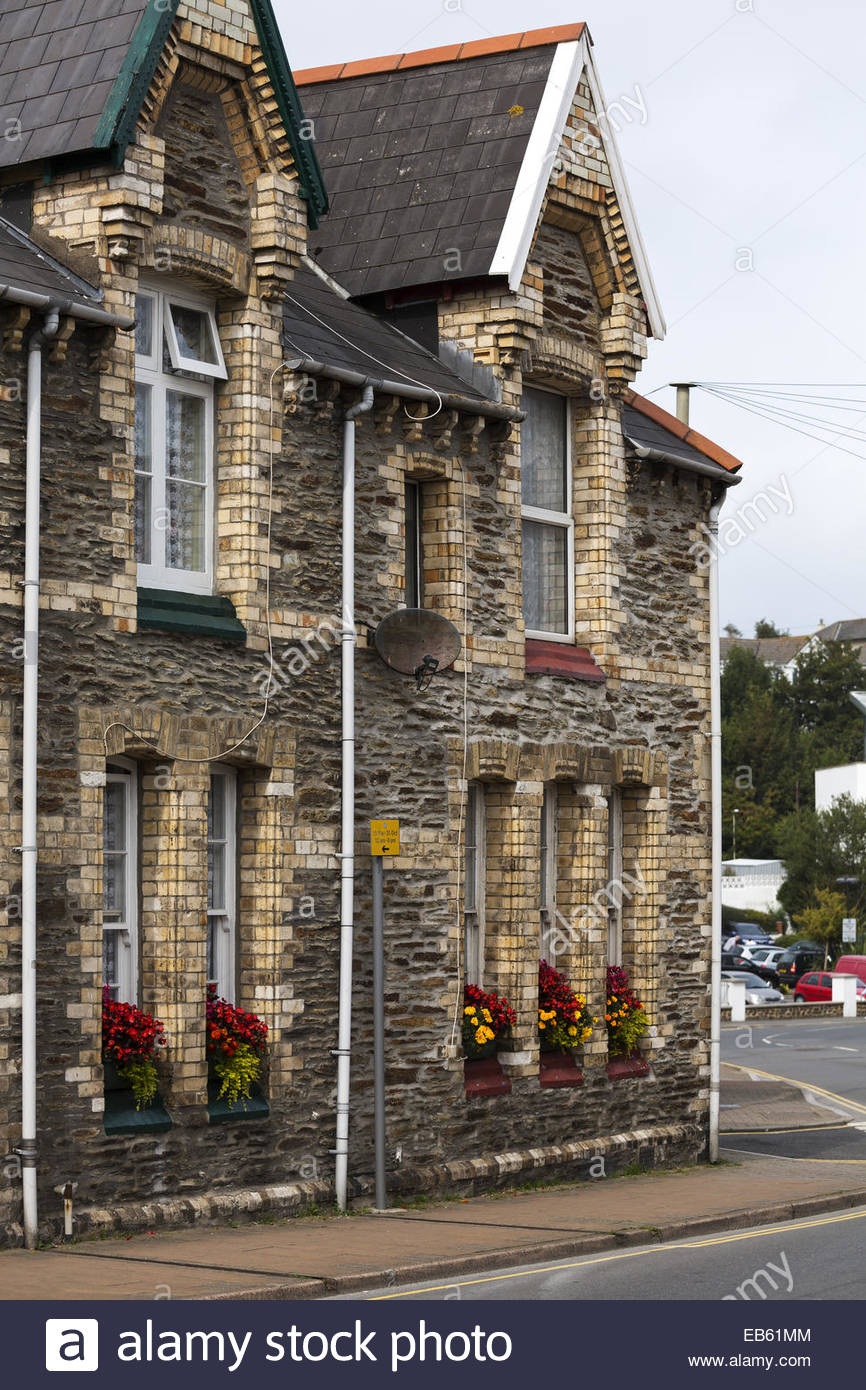 Brick and stone terraced houses with no front garden, Ilfracombe, Devon Stock Photo