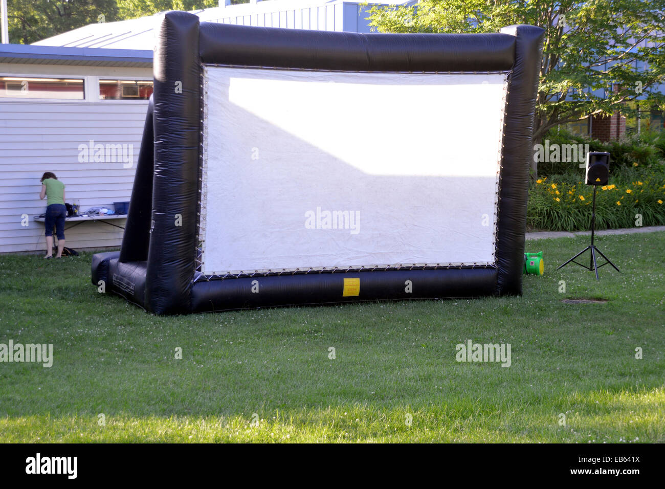 Officials setting up for an outside movie in Greenbelt, Maryland - Stock Image