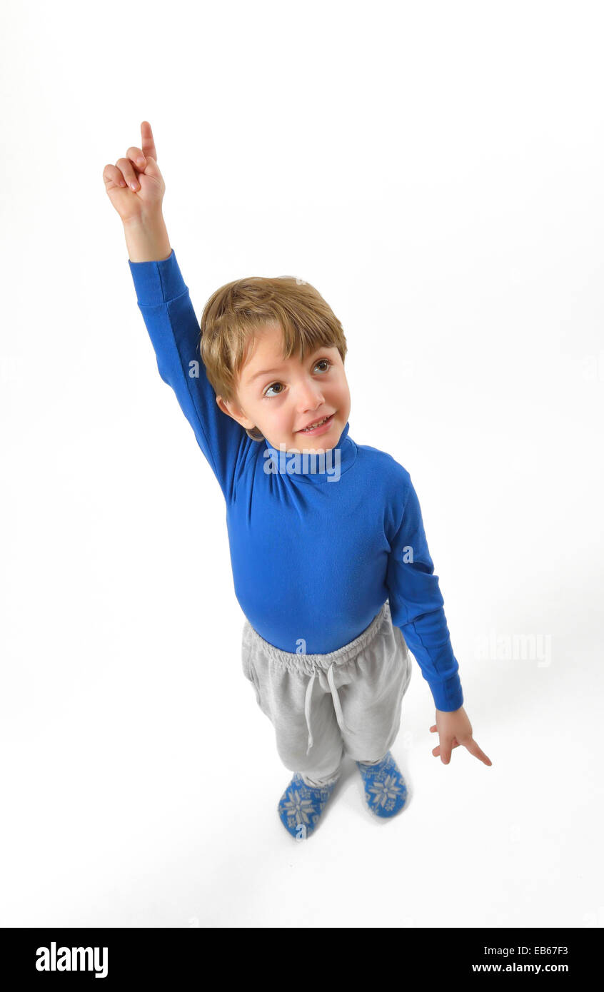 isolated little boy pointing upwards - Stock Image
