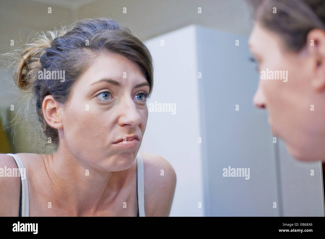 WOMAN WITH MIRROR - Stock Image