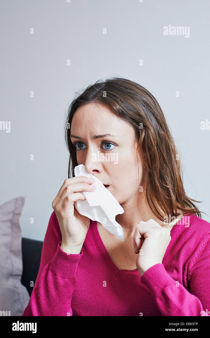 WOMAN WITH RHINITIS - Stock Image