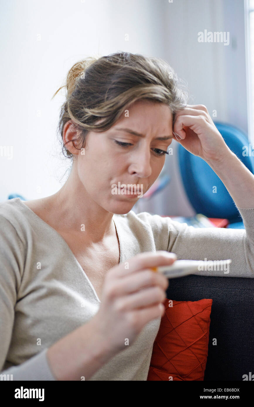 WOMAN WITH FEVER Stock Photo