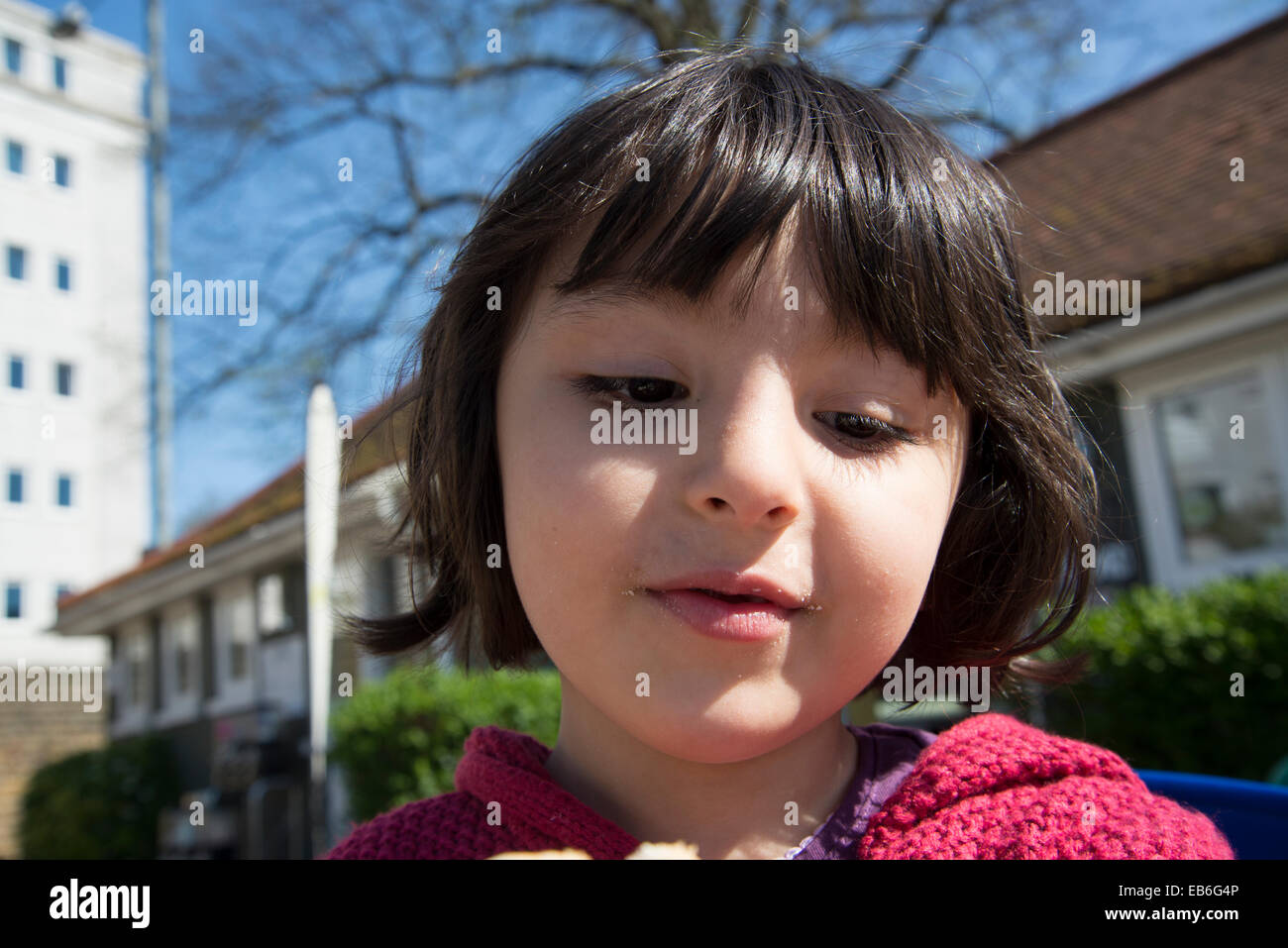 Close up of 5 year old girl's face - Stock Image
