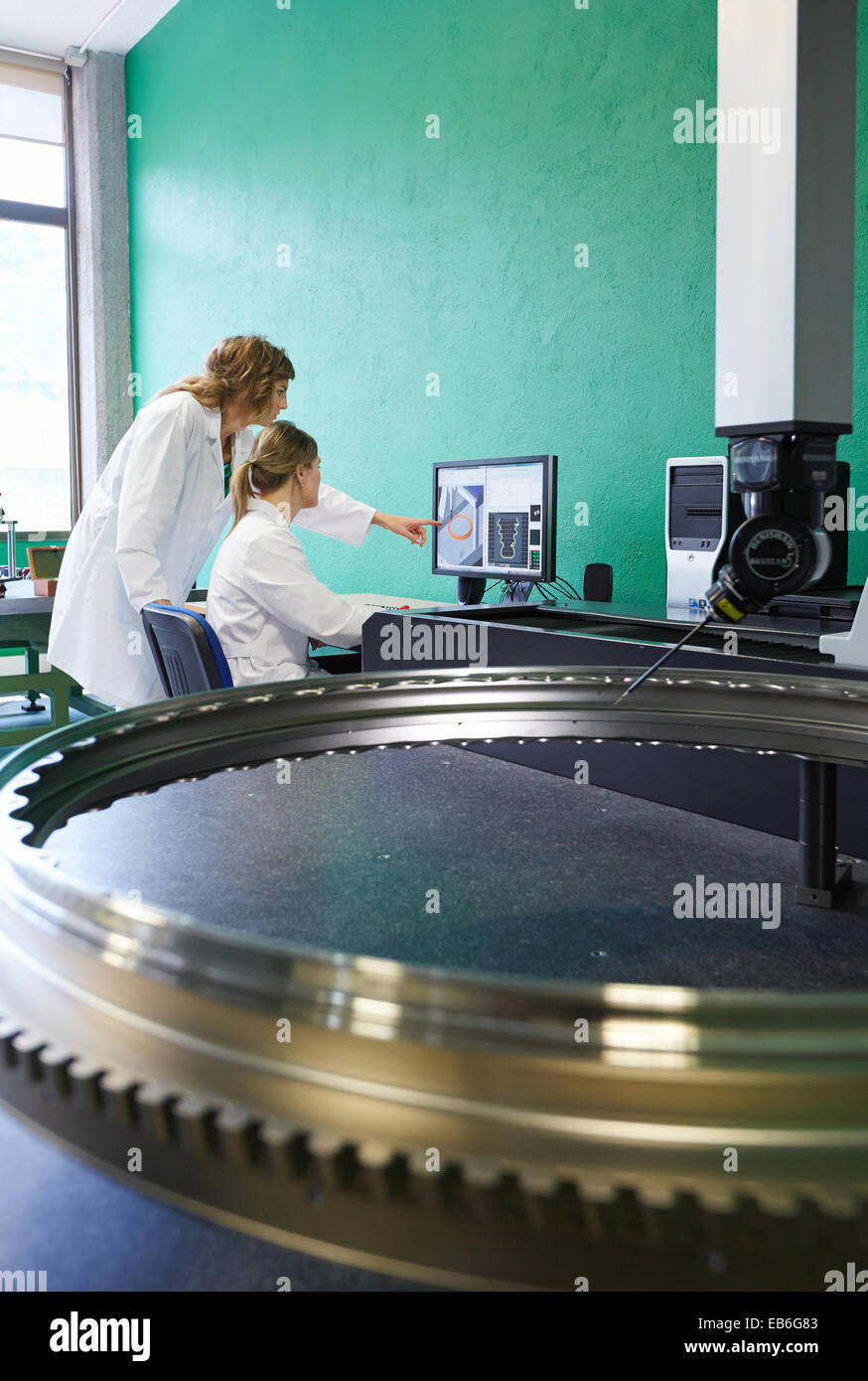 Technicians inspecting aircraft component. Measurement of a piece in CMM. Coordinate Measuring Machine. Innovative - Stock Image