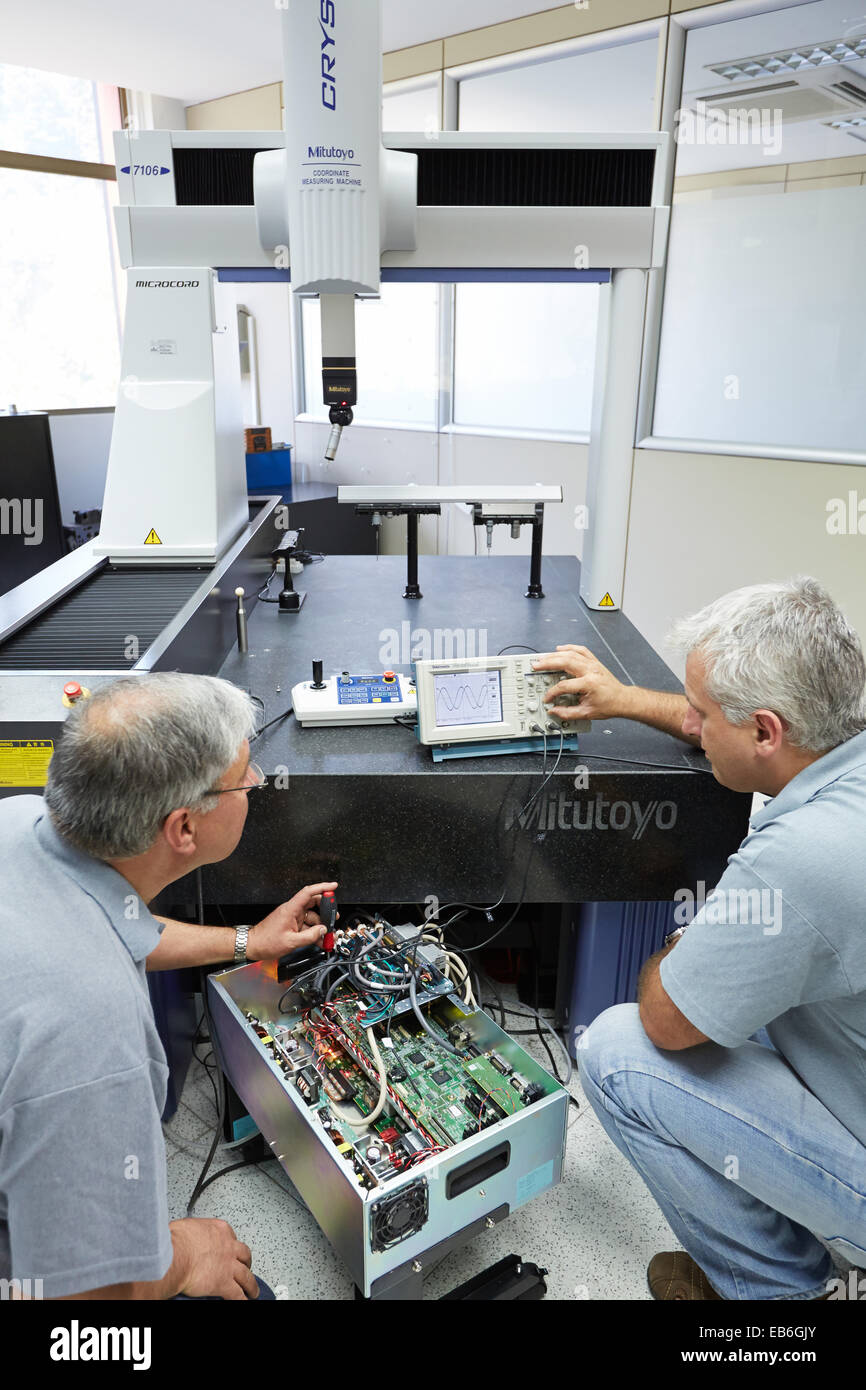The SAT team calibrating three-dimensional machine Calibration CMM Coordinate Measuring Machine Innovative Metrology - Stock Image