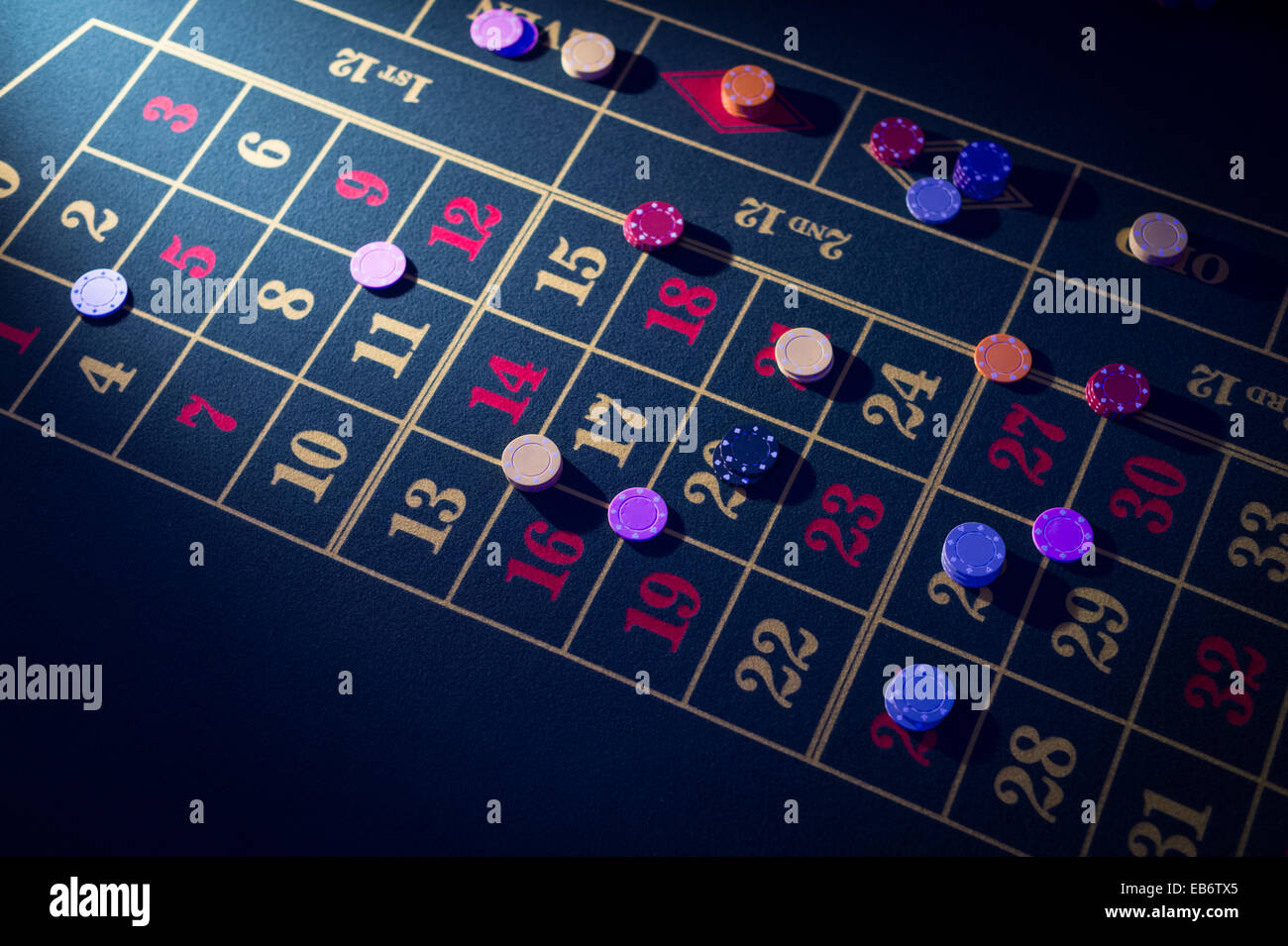 People playing at roulette  gambling in a 'casino' at a wedding reception, UK - Stock Image