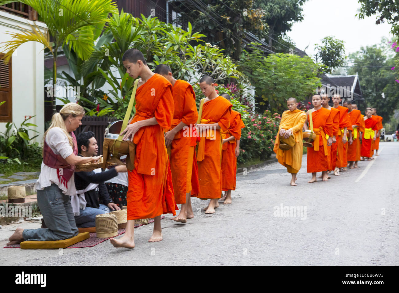 Alms giving ceremony in Luang Prabang, Laos. Stock Photo