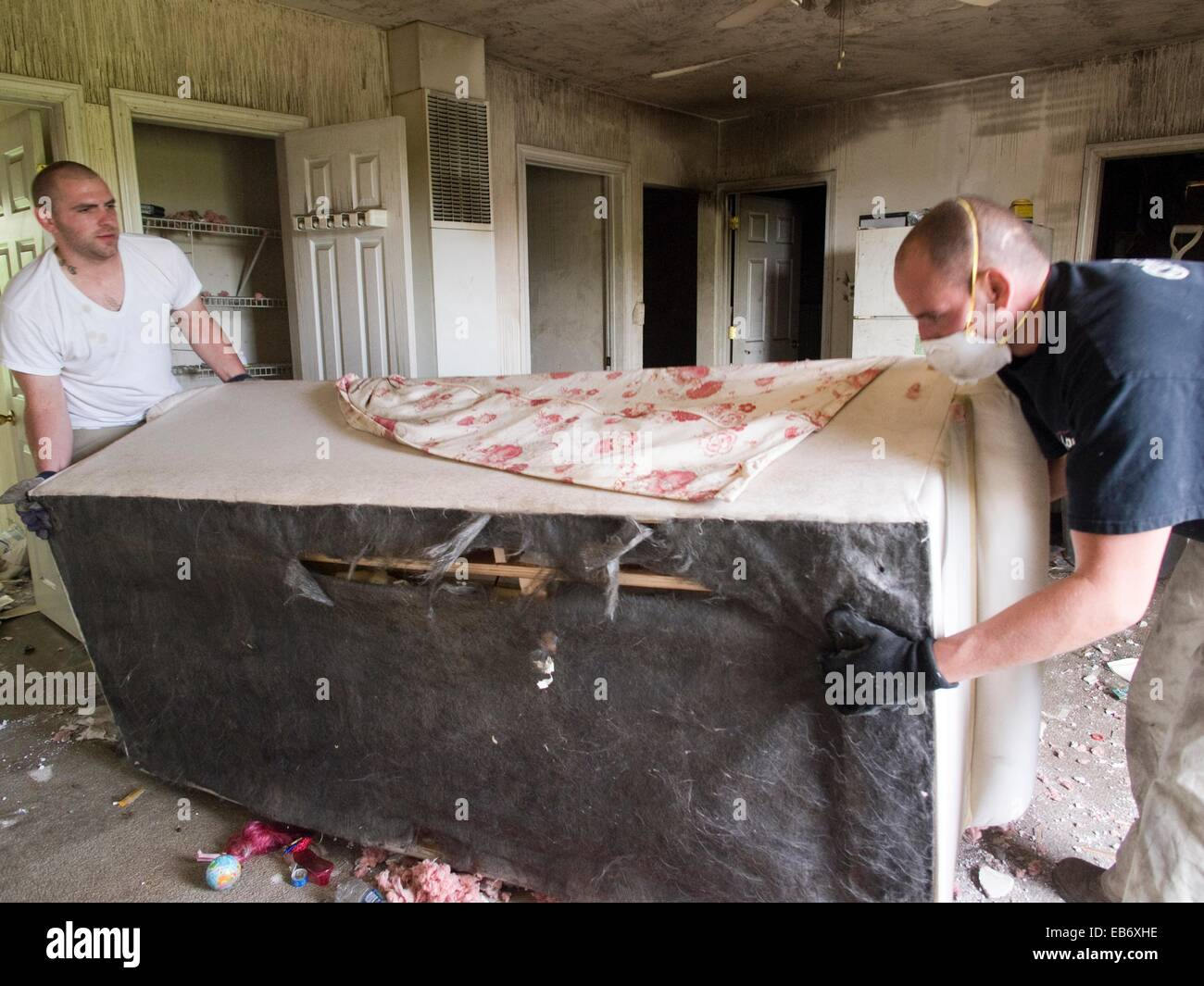 Two men remove items from a foreclosed house in Woonsocket, Rhode Island, United States - Stock Image