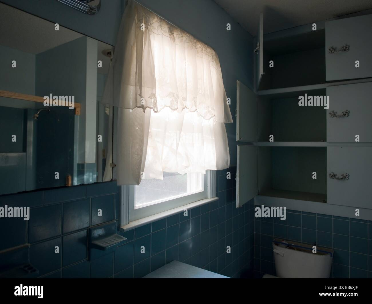 Open And Empty Bathroom Cabinets Inside Of A Foreclosed Home In Lexington,  North Carolina, United States