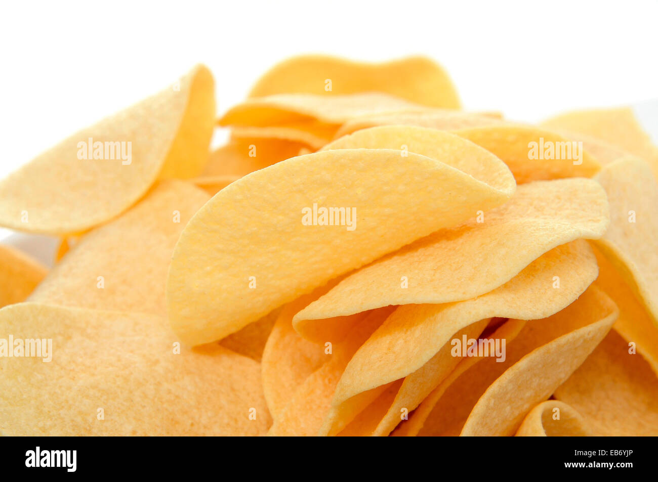 closeup of a pile of low fat potato chips - Stock Image