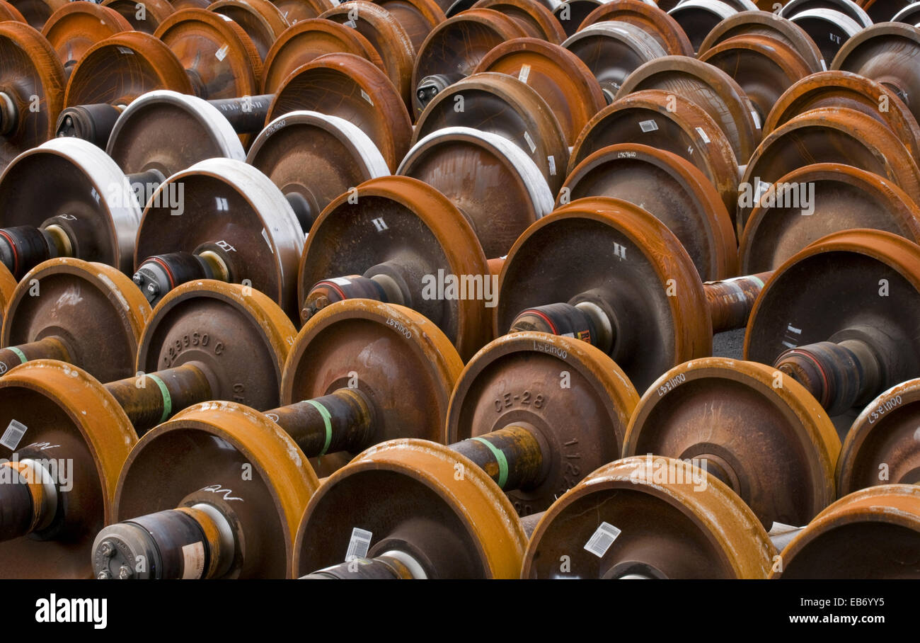 Railroad train wheel and axle assemblies at manufacturing plant, Tacoma, Washington USA. - Stock Image