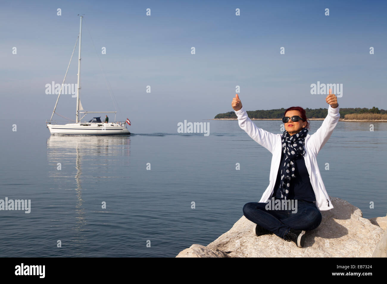 Pretty woman showing OK sign Stock Photo