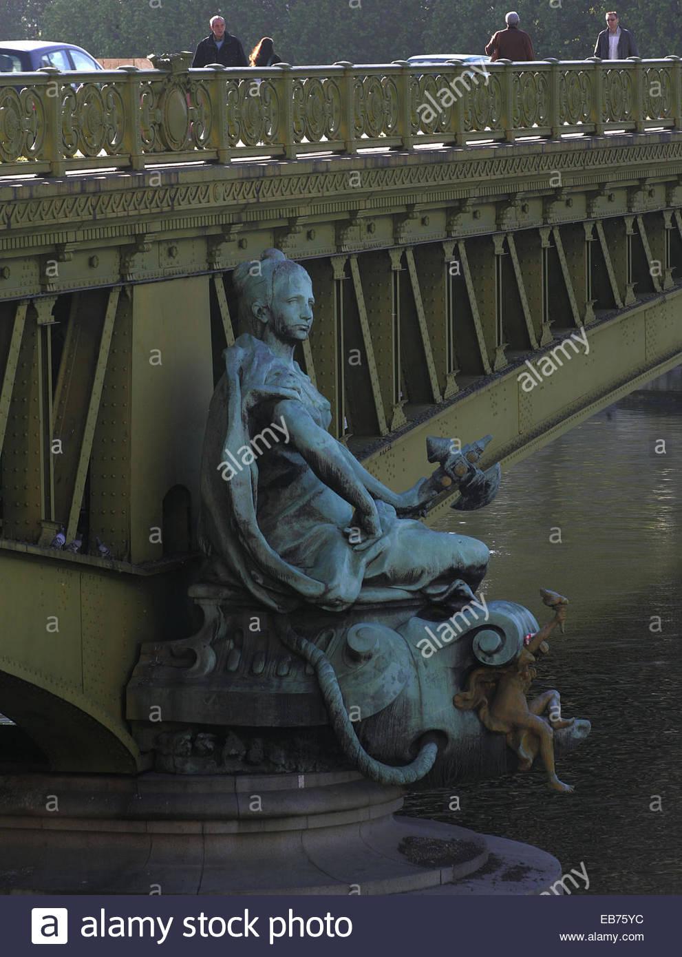 Statue on Mirabeau bridge, Paris. - Stock Image